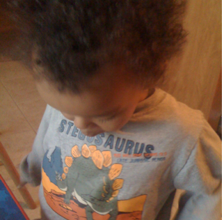 Amani and his dinosaur shirt